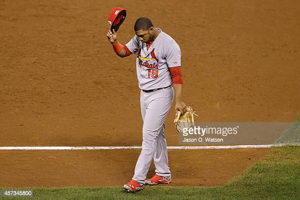 Oscar Taveras of the St Louis Cardinals tips his hat as he walks off the field after the Cardinals lose to the San Francisco Giants 63 during Game...