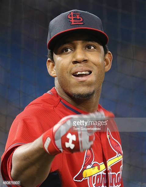 Oscar Taveras of the St Louis Cardinals warms up during batting practice before the start of MLB game action against the Toronto Blue Jays on June 8...
