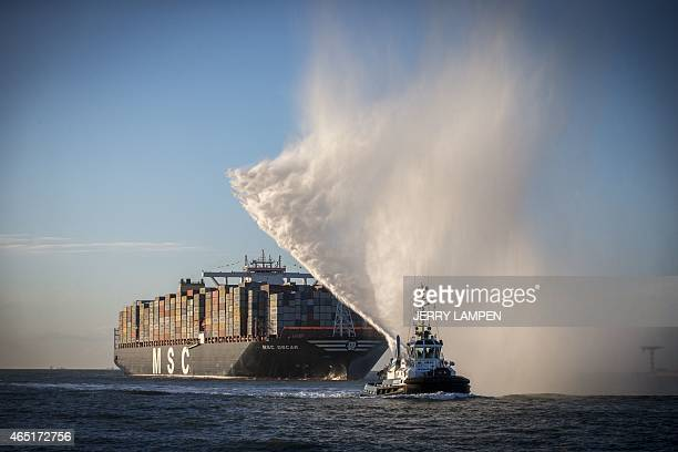 MSC Oscar the largest container ship in the world arrives in the haven of Rotterdam on March 3 2015 At nearly the length of four football fields laid...