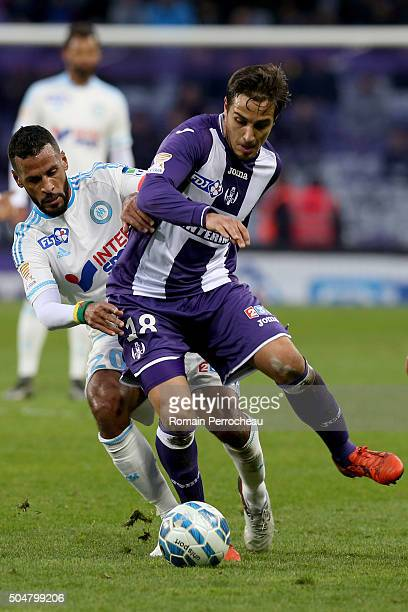 Oscar Trejo for Toulouse and Alaixys Romao for Marseille battle for the ball during the French League Cup quarter final between Toulouse and...