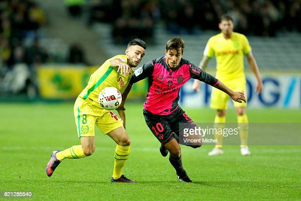 Oscar Trejo of Toulouse and Adrien Thomasson of Nantes during the Ligue 1 match between Fc Nantes and Toulouse Fc at Stade de la Beaujoire on...