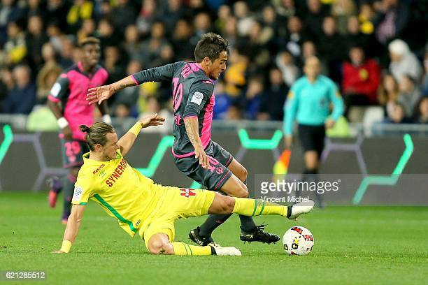 Oscar Trejo of Toulouse and Guillaume Gillet of Nantes during the Ligue 1 match between Fc Nantes and Toulouse Fc at Stade de la Beaujoire on...