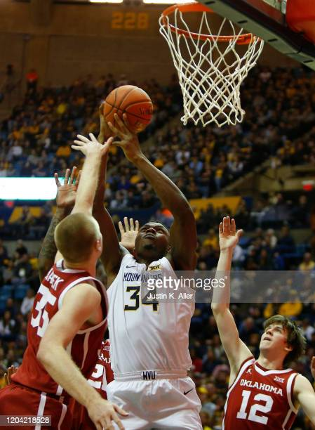 Oscar Tshiebwe of the West Virginia Mountaineers battles for a rebound against the Oklahoma Sooners at the WVU Coliseum on February 29 2020 in...