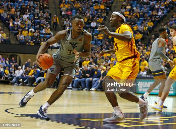 Oscar Tshiebwe of the West Virginia Mountaineers drives the lane against Solomon Young of the Iowa State Cyclones at the WVU Coliseum on February 5...