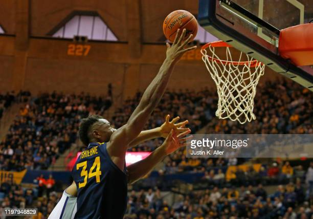 Oscar Tshiebwe of the West Virginia Mountaineers lays one in against the Kansas State Wildcats at the WVU Coliseum on February 1 2020 in Morgantown...
