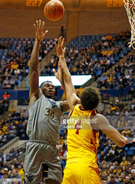 Oscar Tshiebwe of the West Virginia Mountaineers lays one in against George Conditt IV of the Iowa State Cyclones at the WVU Coliseum on February 5...