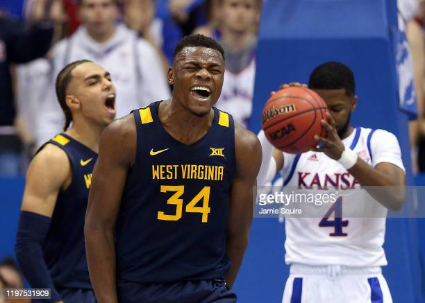 Oscar Tshiebwe of the West Virginia Mountaineers reacts after drawing a foul during the game against the Kansas Jayhawks at Allen Fieldhouse on...