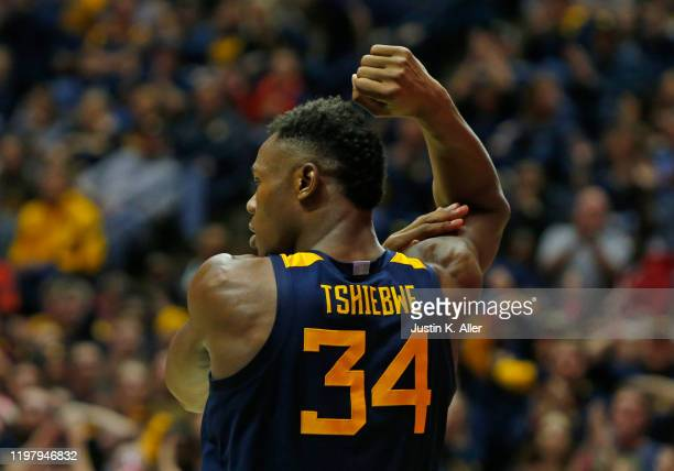 Oscar Tshiebwe of the West Virginia Mountaineers reacts after scoring against the Kansas State Wildcats at the WVU Coliseum on February 1 2020 in...