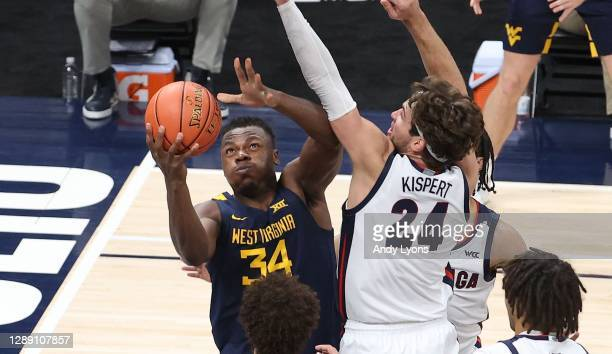 Oscar Tshiebwe of the West Virginia Mountaineers shoots the ball against the Gonzaga Bulldogs during the Jimmy V Classic at Bankers Life Fieldhouse...