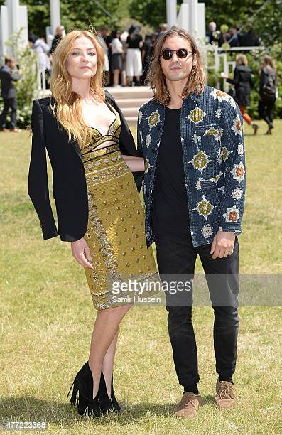 Oscar Tuttiett and Clara Paget arrive at Burberry Menswear Spring/Summer 2016 show at Kensington Gardens on June 15 2015 in London England