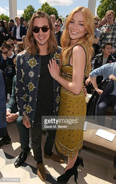 Oscar Tuttiett and Clara Paget attend the front row at Burberry Menswear Spring/Summer 2016 show at Kensington Gardens on June 15 2015 in London...