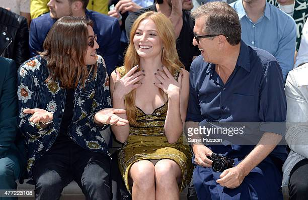 R Oscar Tuttiett Clara Paget and Mario Testino sit in the front row at Burberry Menswear Spring/Summer 2016 show at Kensington Gardens on June 15...