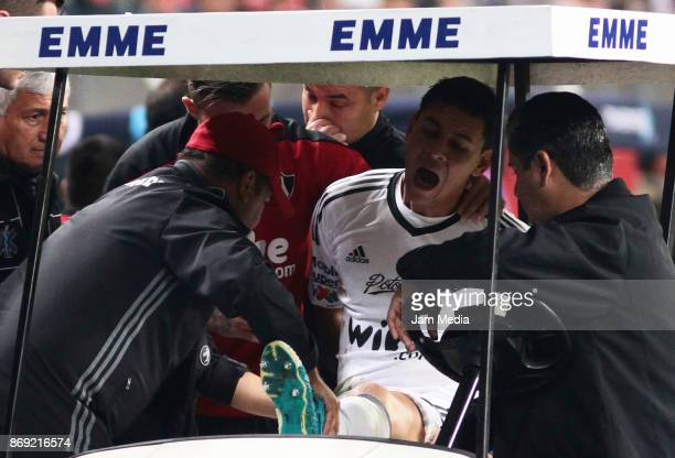 Oscar Ustari of Atlas leaves the field with an injury during the 8th round match between Atlas and Tigers UANL as part of the Torneo Apertura 2017...