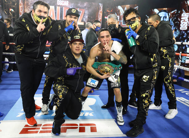 Oscar Valdez and team victory shot after defeating Miguel Berchelt for the WBC super featherweight title at the MGM Grand Conference Center on...