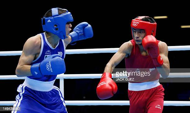 Oscar Valdez Fierro of Mexico and Shiva Thapa of India exchange blows during their round of 32 Bantam bout of the 2012 London Olympic Games on July...