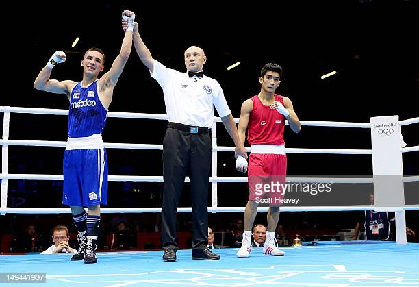 Oscar Valdez Fierro of Mexico celebrates his victory over Shiva Thapa of India during their Men's Bantam Weight bout on Day 1 of the London 2012...