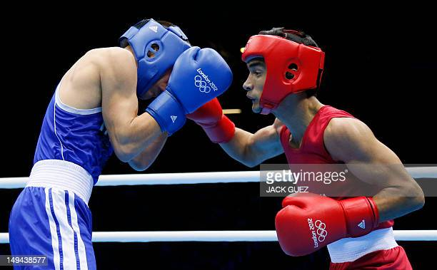 Oscar Valdez Fierro of Mexico defends against Shiva Thapa of India during their round of 32 Bantam bout of the 2012 London Olympic Games on July 28...