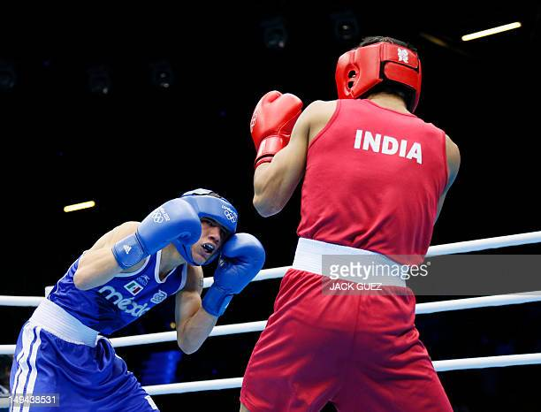 Oscar Valdez Fierro of Mexico measures Shiva Thapa of India during their round of 32 Bantam bout of the 2012 London Olympic Games on July 28 2012 at...