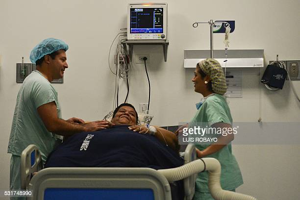 Oscar Vasquez Morales considered the most obese male of country with about 400 kg gestures next to bariatric surgeon Juan del Castillo on May 16 2016...
