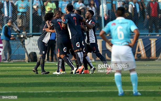 Oscar Vilchez of Alianza Lima celebrates with teammates after scoring during a match between Sporting Cristal and Alianza Lima as part of Torneo...
