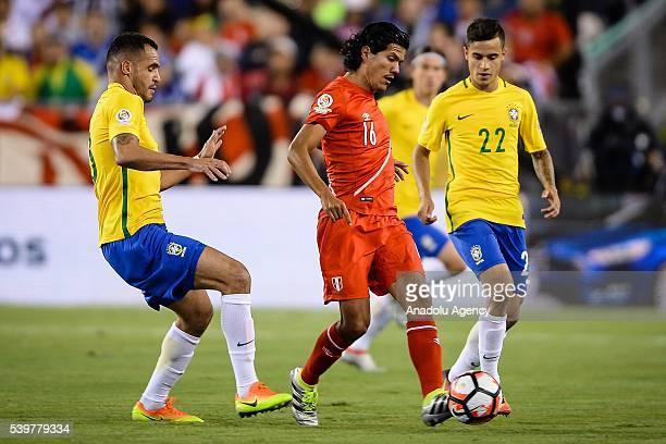 Oscar Vilchez of Peru struggle for the ball against Renato Augusto and Philippe Couthino of Brazil during the 2016 Copa America Centenario Group B...
