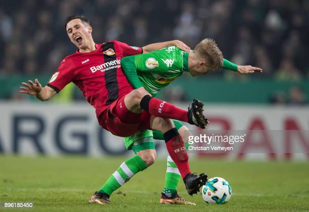 Oscar Wendt of Borussia Moenchengladbach and Dominik Kohr of Bayer 04 Leverkusen battle for the ball during the DFBCup match between Borussia...