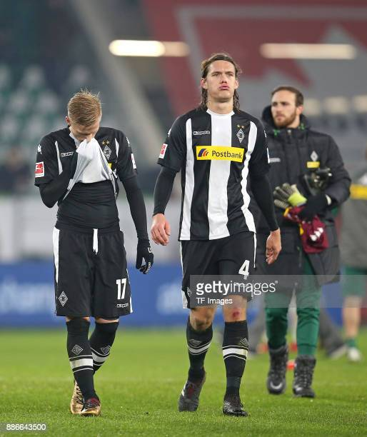 Oscar Wendt of Borussia Moenchengladbach and Jannik Vestergaard of Borussia Moenchengladbach looks dejected during the Bundesliga match between VfL...