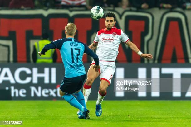 Oscar Wendt of Borussia Moenchengladbach and Kaan Ayhan of Fortuna Duesseldorf battle for the ball during the Bundesliga match between Fortuna...