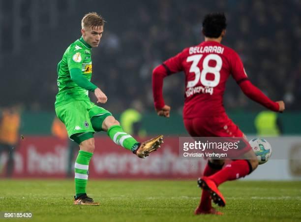 Oscar Wendt of Borussia Moenchengladbach and Karim Bellarabi of Bayer 04 Leverkusen battle for the ball during the DFBCup match between Borussia...