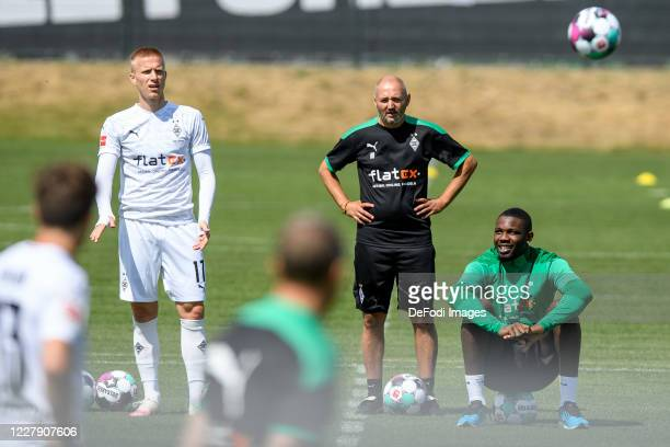 Oscar Wendt of Borussia Moenchengladbach assistant coach Oliver Neuville of Borussia Moenchengladbach and Marcus Thuram of Borussia Moenchengladbach...