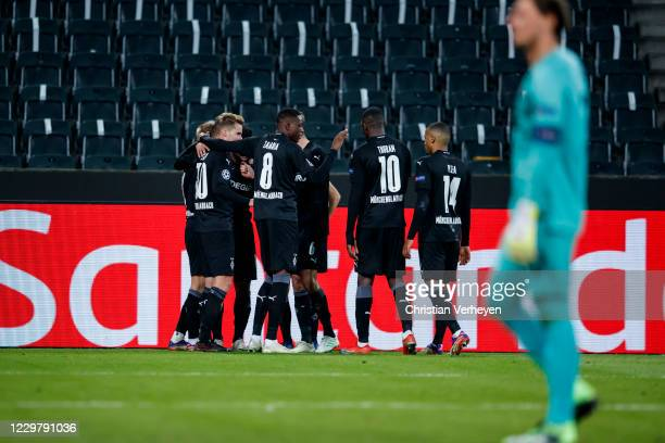 Oscar Wendt of Borussia Moenchengladbach celebrate with teammates after he score his teams fourth goal during the Group B UEFA Champions League match...