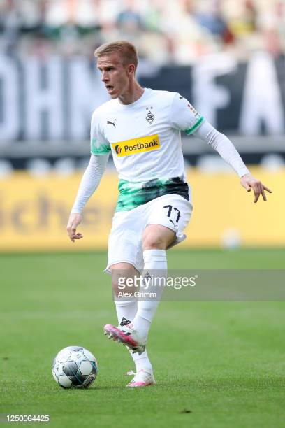 Oscar Wendt of Borussia Moenchengladbach runs with the ball during the Bundesliga match between Borussia Moenchengladbach and VfL Wolfsburg at...