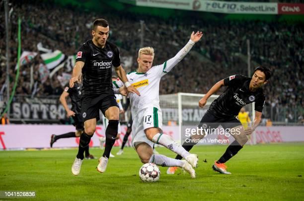 Oscar Wendt of Borussia Monchengladbach and Filip Kostic of Eintracht Frankfurt battle for the ball during the Bundesliga match between Borussia...