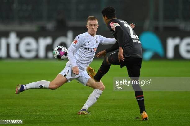 Oscar Wendt of Borussia Monchengladbach and Theodor Gebre Selassie of SV Werder Bremen battle for possession during the Bundesliga match between...