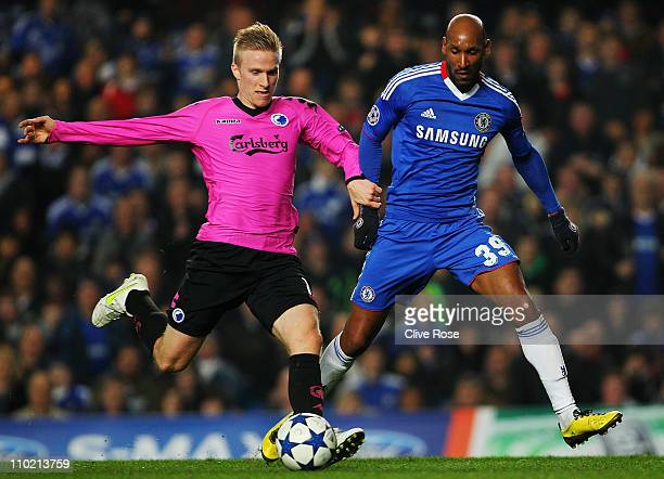 Oscar Wendt of FC Copenhagen and Nicolas Anelka of Chelsea challenge for the ball during the UEFA Champions League round of sixteen second leg match...