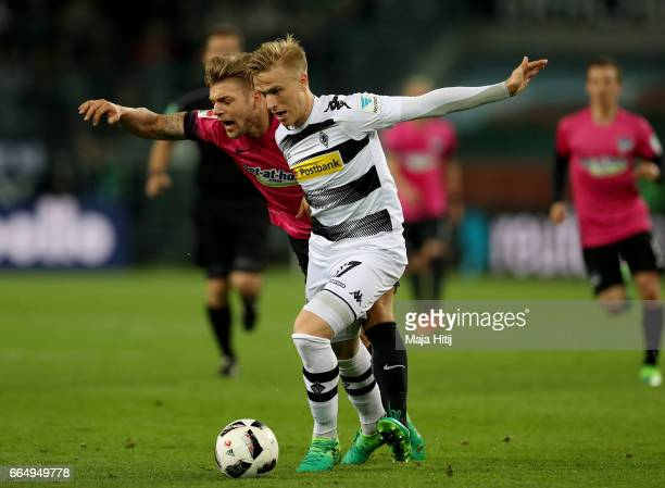 Oscar Wendt of Gladbach and Alexander Esswein of Berlin battle for the ball during the Bundesliga match between Borussia Moenchengladbach and Hertha...