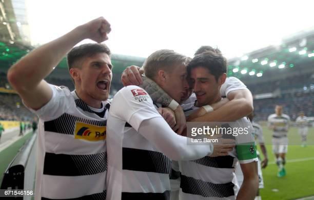 Oscar Wendt of Moenchengladbach celebrates with Jonas Hofmann of Moenchengladbach Lars Stindl of Moenchengladbach and Ibrahima Traore of...