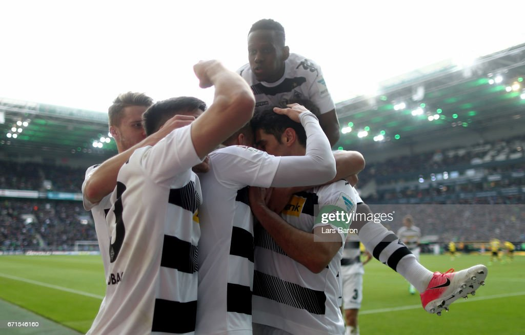 Oscar Wendt of Moenchengladbach celebrates with Jonas Hofmann of Moenchengladbach, Lars Stindl of Moenchengladbach and Ibrahima Traore of Moenchengladbach after scoring his teams second goal during the Bundesliga match between Borussia Moenchengladbach and Borussia Dortmund at Borussia-Park on April 22, 2017 in Moenchengladbach, Germany.