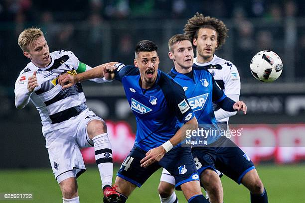 Oscar Wendt of Moenchengladbach Sandro Wagner Pavel Kaderabek of Hoffenheim and Fabian Johnson of Moenchengladbach battle for the ball during the...