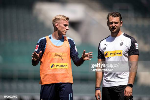 Oscar Wendt talks to tAssistant Coach Rene Maric of Borussia Moenchengladbach during a Training Session of Borussia Moenchengladbach at BorussiaPark...