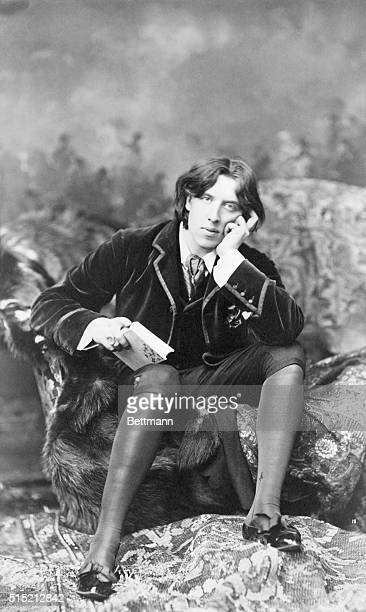 Oscar Wilde in pensive mood sitting on divan Photo taken during his stay in America in the 1880's BPA