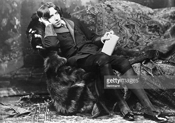 Oscar Wilde relaxing on the divan during his lecture trip through America