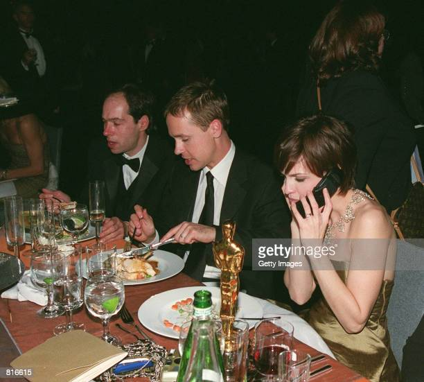 Oscar Winner Hilary Swank talks on a cell phone while attending the Governor's Ball March 26 2000 following the 72nd Academy Awards in Los Angeles...