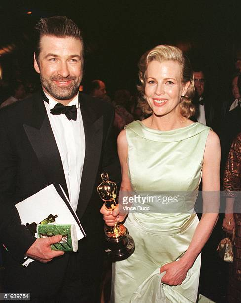 Oscar winner Kim Basinger and her husband actor Alec Baldwin celebrate at the Governor's Ball following the 70th Annual Academy Awards 23 March in...