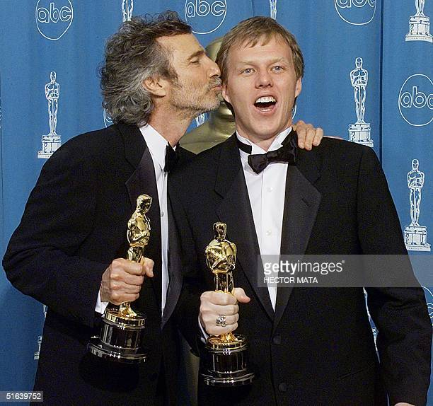 Oscar winners for Best Adapted Screenplay Curtis Hanson and Brian Helgelow pose for photographers 23 March at the 70th Annual Academy Awards at the...