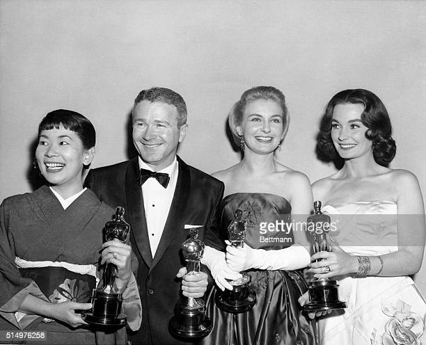 Miyoshi Umeki and Red Buttons voted Best Supporting Actress and Actor for their roles in Sayonara Joanne Woodward who received the Best Actress award...