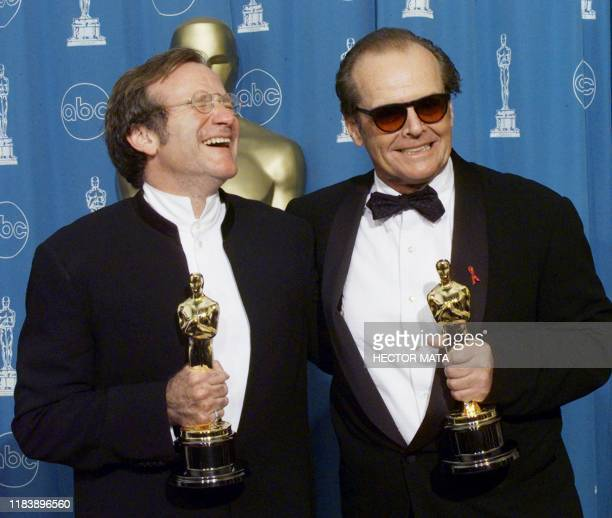 Oscar winners Robin Williams Best Supporting Actor and Jack Nicholson Best Actor pose for photographers 23 March at the 70th Annual Academy Awards at...