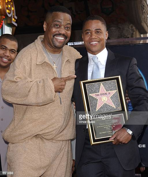 Oscar winning actor Cuba Gooding Jr celebrates with his father Cuba Gooding Sr during star ceremony on the Hollywood Walk of Fame January 17 2002 in...