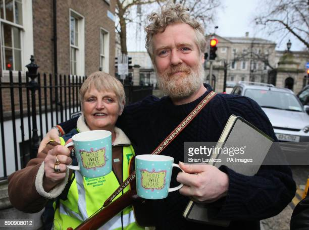 Oscar winning Singer Glen Hansard with a cup saying 'Home Sweet Home' given to him by homeless campaigner Sheila O'Byrne ahead of his performance at...