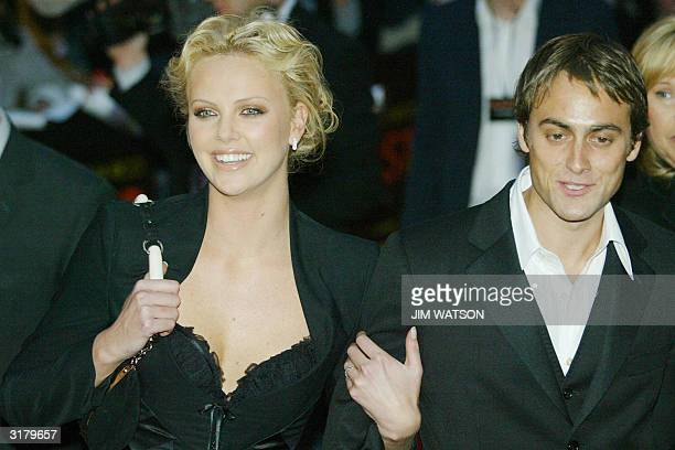 Oscar winning South African actress Charlize Theron arrives with fiance Stuart Townsend at the Warner Village Theatre in London for the premiere of...